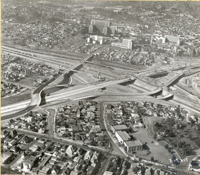 Interstate 5 Interchange with Interstate 10 looking northerly.  To the right is the San Bernardino Freeway toward Pomona.  To the left is Los Angeles. State Street structure is directly in front of the County Hospital.  Nov. 15, 1959.