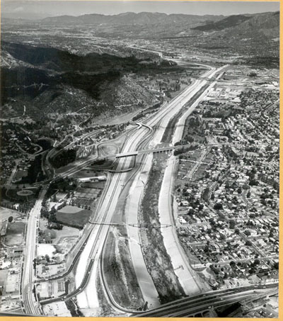 California - Looking northwesterly along Golden State Freeway with the Las Feliz Boulevard interchange in the center of the picture.  The cities of Burbank and Glendale are in the background.  May 12, 1959.