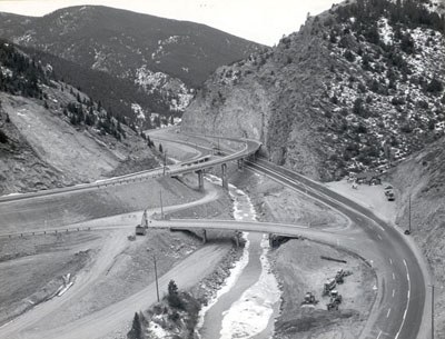 Colorado - Interstate Route 70 westerly from Denver (Colorado Interstate Project I-70-3(1)250)). View looking northwest showing the Floyd Hill interchange completed except for a small amount of cleanup work.  The project was officially opened to traffic on Dec. 11, 1959.