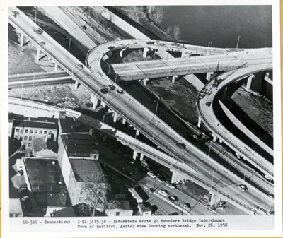 Connecticut - I-91-3(15)38 - Interstate Route 91 - Founders Bridge interchange in Hartford.  Aerial view looking northeast.  Nov. 26, 1958