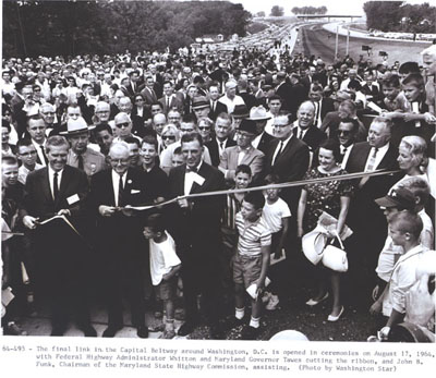 Capital Beltway - Maryland - The final link in the Capital Beltway around Washington, D.C. is opened in ceremonies on August 17, 1964, with Federal Highway Administrator Rex Whitton and Maryland Governor Millard Tawes cutting the ribbon, and John B. Funk, Chairman of the Maryland State Highway Commission, assisting.  (Photo by Washington Star)