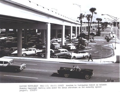 Florida - I-4 (Section 75280-3417) in Orange County - America to Washington Street in Orlando showing Municipal Parking Area under the large structure on the recently opened project. 7-19-62.
