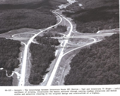 Georgia - The interchange between Interstate Route 285 (bottom & top) and Interstate 75 (right & left) northwest of Atlanta, illustrates the beauty achieved through varying roadway elevations and median widths and selective clearing in the original design and construction of a highway.