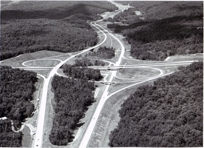 Georgia - The interchange between Interstate Route 285 (Bottom- Top) and Interstate 75 (Right - Left) northwest of Atlanta, Illustrates the beauty achieved through varying roadway elevations and median width and selective clearing in the original design and construction of a highway.