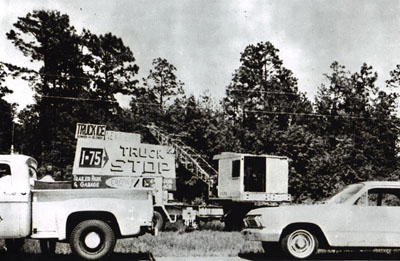 Georgia - Highway Department maintenance forces are shown removing a billboard erected in violation of State law controlling outdoor advertising from alongside Interstate 75 in south Georgia during a May, 1965, clean-up of unauthorized signs.