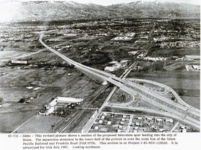 Idaho - This revised picture shows a section of the proposed Interstate spur leading into the city of Boise.  The separation structure in the lower half of the picture is over the main line of the Union Pacific Railroad and Franklin Road (FAS 3779).  This section is on Project I-IG-80N-1(22)50, now Inerstate 184.  It is advertised for bids July 1967.  Looking northeast.