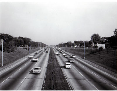 Congress St. Expressway (Interstate 90) from 17th st. overpass looking East, showing depressed section with good landscaping, steel cable guard rail, 10 foot paved shoulder, 24 foot median.  Residential Area.  Chicago, Illinois.  Photo by T. W. Kines 10-12-60