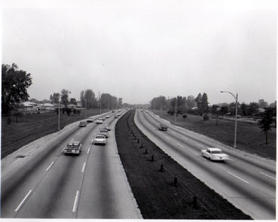 Interstate 94 (Edens Expressway) View showing 6 traffic lanes, 24 foot median with steel cable guard rail - looking N.W. from Oakton St. Chicago, Illinois.