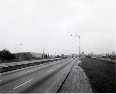 Interstate 94 (Edens Expressway) View of Edens Expressway showing commercial development left and residential section right.  Looking N.W. between Touchy Ave. and Oakton Street.  Chicago Illinois.