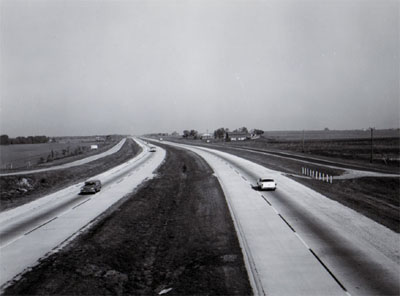 INTERSTATE 55 Looking north showing frontage roads, 48 foot depressed median, 10 foot gravel shoulders and 24 foot concrete pavement.  Miles north of US 52