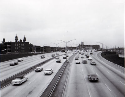 View of Northwest Expressway sowing a section of reversible roadway with 6 lanes of traffic.  Looking West from Augusta Blvd.  Chicago, Illinois. Photo by T.W. Kines 5-8-61