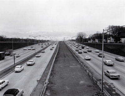 Interstate 94 Chicago, Illinois.  View of Northwest Expressway showing heavy traffic on a section of reversible roadway with 6 lanes of traffic.  Looking West from Irving Park overpass.