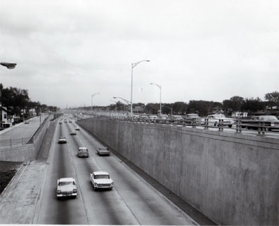 View of Congress Street Expressway (I-90) showing exit ramp from Congress Street Expressway to Harlem Avenue From West bound lane.  Looking east. Chicago Ill.