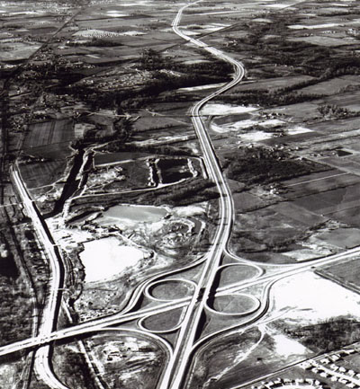 Interstate Route 74 and 465 meet on the west side of Indianapolis, Ind.  Interstate 465, running across the picture, is part of the Indianapolis circumferential freeway.