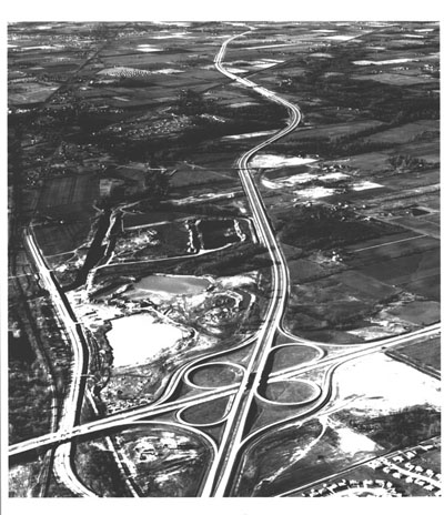 Indiana - Interstate Routes 74 & 465 meet on the west side of Indianapolis. Interstate 465, running across the picture, is part of the Indianapolis circumferential freeway.