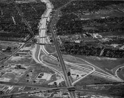 Ford Expressway.  Michigan Avenue interchange in foreground.  McGraw Ave on left and Michigan Avenue on right of Ford Expressway.  Wyo ming Ave is under RR track crossing and intersects Mich Ave at grade in foreground