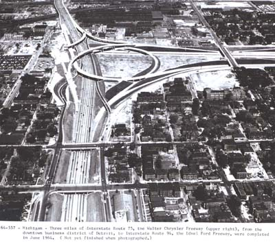 Three mile of Interstate Route 75, the Walter Chrysler Freeway (upper right), from the downtown business district of Detroit, to Interstate Route 94, the Edsel Ford Freeway, were completed in June 1964.  (Not yet finished when photographed.)