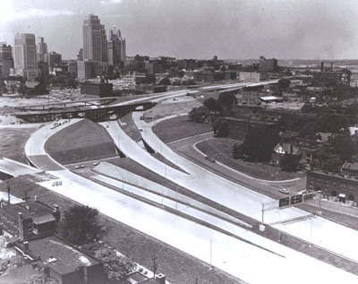 Missouri - The Kansas City central business district, looming in the distance above, is shown close up below, served by the Inner loop section of I-70.  (Construction was underway at the time of this photograph.)