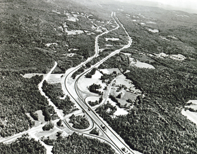 New Hampshire- Interstate Route 93 near Sanbornton, illustrates the use of independent roadway design and the preservation of trees on the roadside and in the median, for scenic effect and economy.