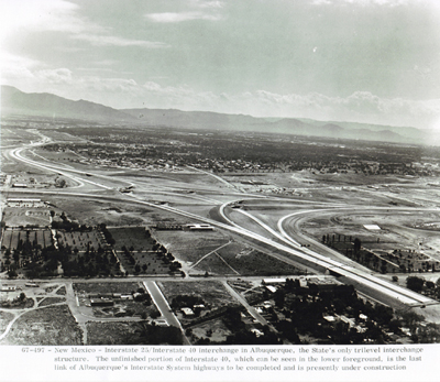 New Mexico - Interstate 25/Interstate 40 interchange in Albuquerque, the State's only tri-level interchange structure.  The unfinished portion of Interstate 40, which can be seen in the lower foreground, is the last link of Albuquerque's Interstate System to be completed and is presently under construction.
