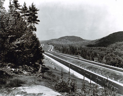 New York - A view along the 23-mile section of the Adirondack Northway (Interstate Route 87) which was adjudged America's Most Scenic New Highway of 1966 by Parade Magazine.  The section, between Lake George and Potterville in Warren County, is part of the 176-mile-long Albany-to-Canada Expressway.