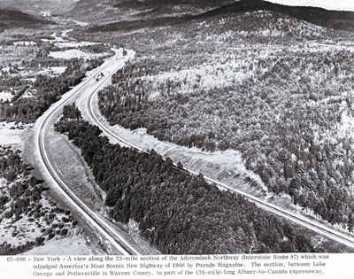New York- A view along the 23-mile section of the Adirondack Northway (Interstate Route 87) which was adjudge America's Most Scenic New Highway of 1966 by Parade Magazine. The section, between Lake George and Potterville in Warren County, is part of the 176-mile-long Albany-to-Canada expressway.
