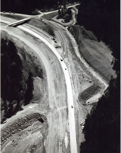 Oregon - Construction underway on one of the last segments of Oregon's I-5 south of Canyonville.  Shown here is the West Fore Interchange taking shape, with the two southbound lanes of the freeway in use.