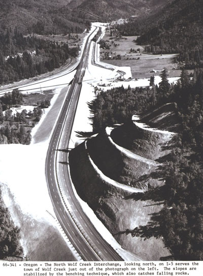 Oregon - The North Wolf Creek interchange, looking north, on I-5 serves the town of Wolf Creek just out of the photograph on the left. The slopes are stabilized by the benching technique, which also catches falling rock.