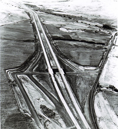 Oregon- Looking northwest at Farewell Bend Interchange on newly constructed portion of I-84 in Eastern Oregon.  Old U.S. 30 is shown on the right.
