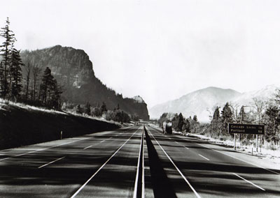 Oregon - Looking westerly from Hood River toward the Mitchell Point-Cascade Locks Section of I-80N(now I-84) recently opened to traffic.