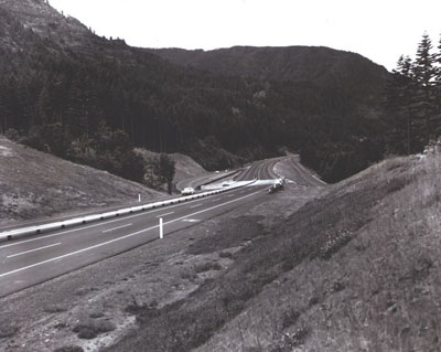 Oregon - Interstate Route 80N (now I-84) travels rough country along the Columbia River near Cascade Locks.  A narrow median with safety guard rail was used, since a broad median would have been too costly.