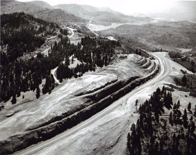 Oregon - This is the southernmost section of Oregon's I-5 with the California State line just beyond the next hill.  Looking southerly along the split-level freeway.  At upper left, the old Pacific Highway U.S. 99 shows up at a former location.