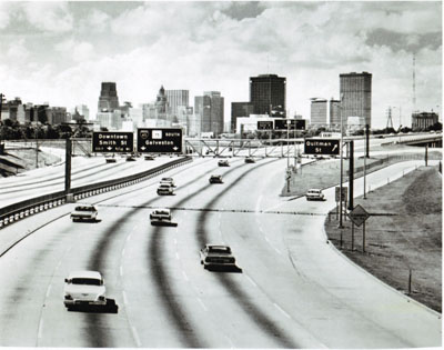 Texas- The towers of Houston rise over the North Freeway (I-45), presenting travelers with a stunning urban panorama.