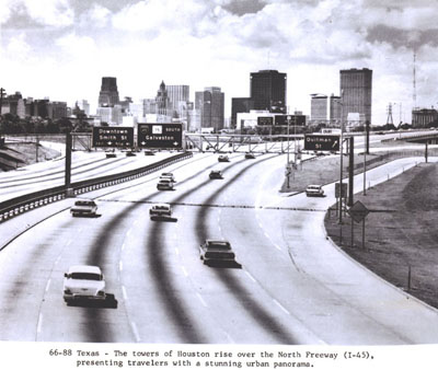 Texas - The towers of Houston rise over the North Freeway (I-45), presenting travelers with a stunning urban panorama.