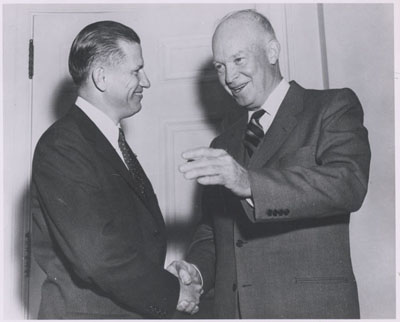 The first Federal Highway Administrator John A. Volpe with President Dwight D. Eisenwhower at the White House on October 22, 1956.