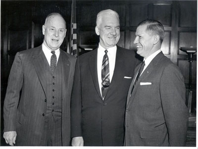 Secretary of Commerce Sinclair Weeks, Bertram Tallamy (who would become Federal Highway Administrator in February 1957) and Mr. John Volpe on the occasion of Mr. Volpe's swearing in as first Administrator, October 22, 1956.