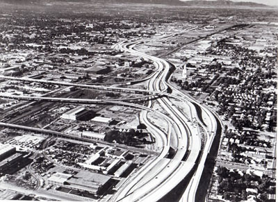 Work on this section of Interstate Routes 15 and 80, leading into Salt Lake City, Utah, from the north, began in 1958.  The elevated roadways leading off to the left are spur routes to the central city.  (Project I-15-7(23), (34), (46), & (51).)