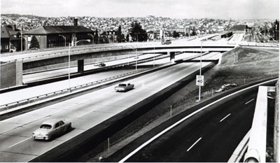Washington- The reversible center roadway (not yet in use)  of the Seattle Freeway, part of Interstate 5, will meet the alternating-direction peak demand of morning and evening rush-hour traffic.
