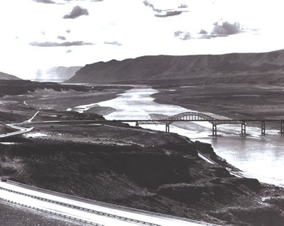 Washington - Interstate Route 90 slopes down from the foreground to cross an impressive structure over the Columbia River near Vantage.  The old bridge at this location was removed, since it would have been submerged after completion of Wanapum Dam downstream.  The public utility district which built the dam contributed $4million toward the new bridge.