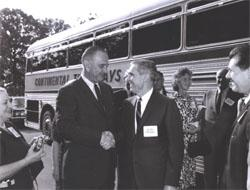 President Lyndon Johnson speaks with Federal Highway Administrator Rex Whitton before he boards the bus for the Landscape-Landmark Tour.  On the right, Deputy Federal Highway Administrator Lawrence Jones looks on.