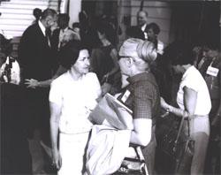 Lady Bird Johnson speaks with tour participant Trudye Fowler, whose husband Henry H. Fowler had taken office as Secretary of the Treasury on April 1, 1965.  Mrs. Johnson and Mrs. Fowler had become friendly during Secretary Fowler's stint as Under Secretary of the Treasury (161-1964).