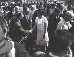 Federal Highway Administrator Rex Whitton introduces Lady Bird Johnson to Douglas B. Fugate, Chairman and Commissioner of the Virginia Department of Highways.  Deputy Federal Highway Administrator Lawrence Jones (looking down) is to Mrs. Johnson's left.  Muriel Humphrey, wife of Vice President Hubert H. Humprey (in striped jacket) is to the right of the picture.