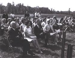 Participants in the Landscape-Landmark Tour listen to introductory remarks by Douglas B. Fugate, Chairman and Commissioner of the Virginia Department of Highways, at the Dumfries Wayside Shelter on I-95 in northern Virginia.  In front row, left to right, Virginia Governor Albertis Harrison, Lady Bird Johson, Federal Highway Administrator Rex Whitton, Muriel Humphrey, wife of Vice President Hubert H. Humphrey, and Mrs. Harrison.