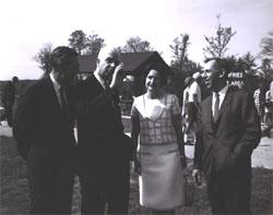 Left to right, Federal Highway Administrator Rex Whitton, Virginia Governor Albertis Harrison, Lady Bird Johnson, and Douglas B. Fugate, Chairman and Commissioner of the Virginia Department of Highways talk at the dedication of the I-95 Dumfries Wayside Shelter.