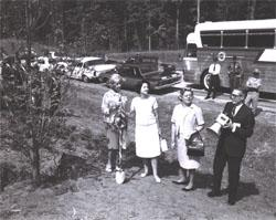 Left to right, at planting of dogwood tree along I-95 in Virginia, Muriel Humphrey, wife of Vice President Hubert H. Humphrey, Lady Bird Johnson, unidentified woman, and Federal Highway Administrator Rex Whitton.