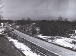 Winter traffic on I-95 in Virginia, with last remnants of snow along the roadside.