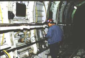 The inspector examines the steel lining near the Glenmont Station of the Washington Metro. (Photo courtesy of the Washington Metropolitan Area Transit Authority)