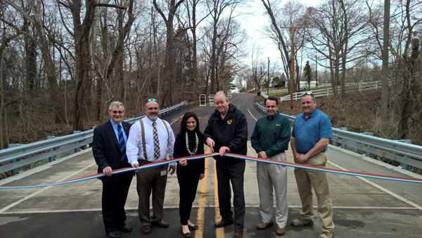 Curtis Shugars, Vincent Voltaggio, Heather Simmons, Robert Damminger, Ron Moore and Michael Sheahen celebrate the opening of the new Jessup Mill Road Bridge.