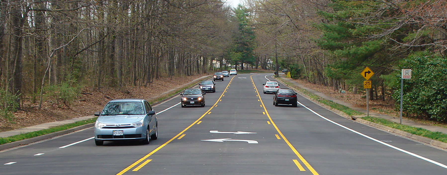 Two lane road with middle turn lanes