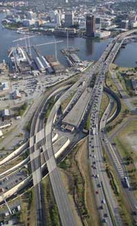 Photo. Overhead view traffic driving on a highway that crosses a river.
